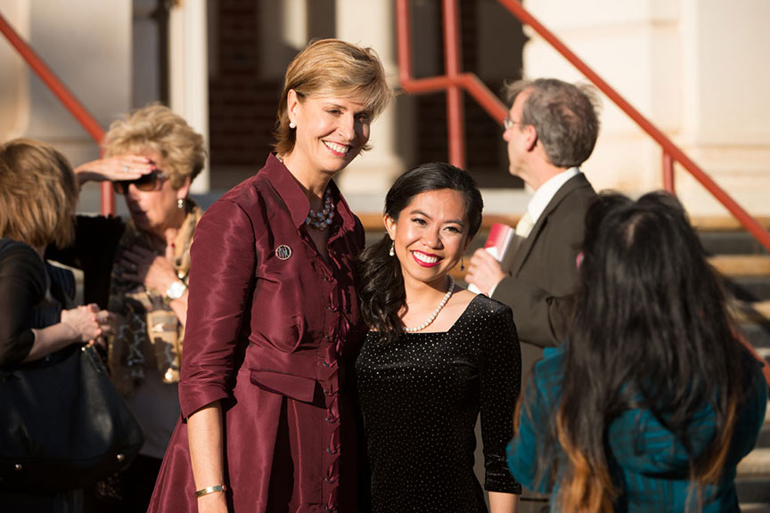 Chancellor Feyten poses for a photo with a young woman in a black dress