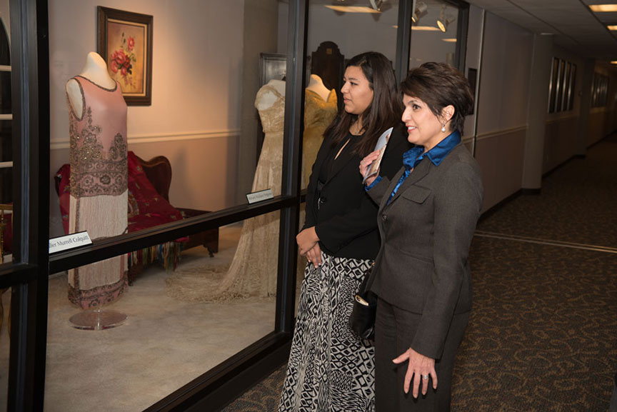 two women looking at the Texas First Ladies' Historic Costume Collection