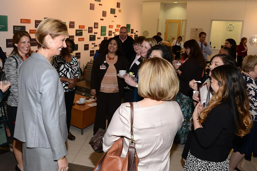 Chancellor Feyten chats with a group of women