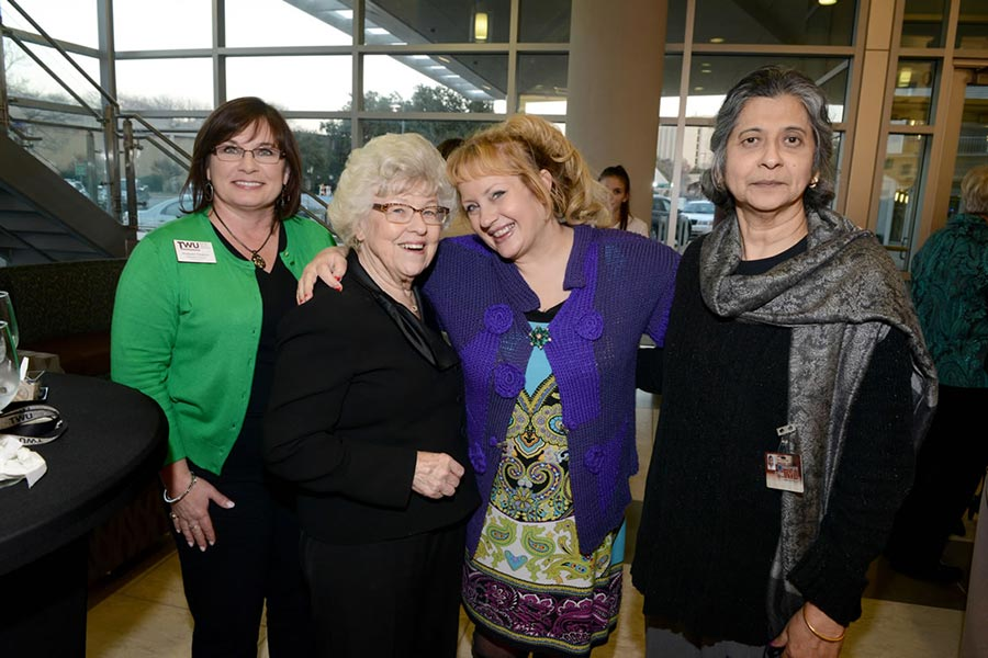 A group of four women, including Stephanie Stevens, Karen Long-Trail, and Kam Mukherjee