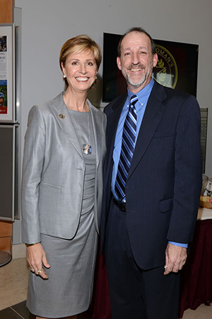 Chancellor Feyten poses with a man in a blue suit and tie