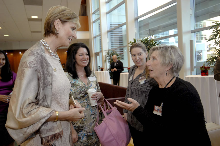Chancellor Feyten speaks with reception guests