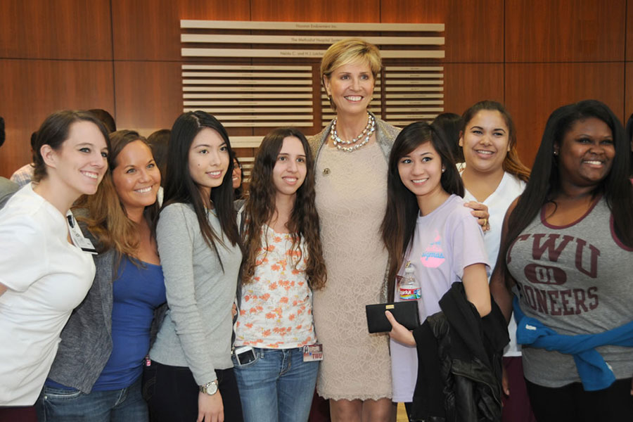 Chancellor Feyten poses with a group of students