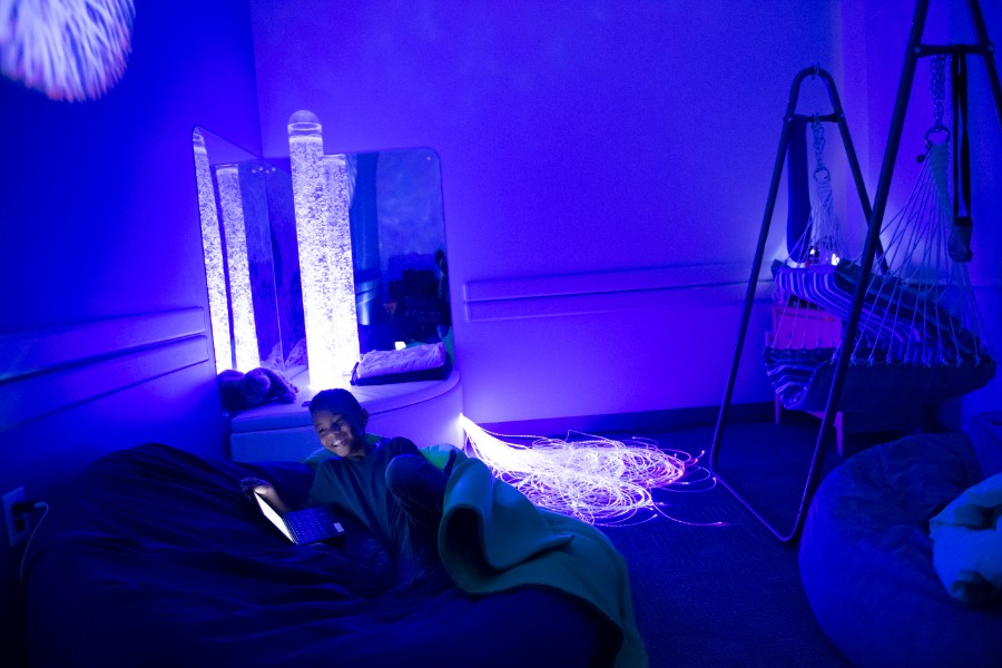 A young boy relaxes in the sensory room on TWU's Dallas campus.