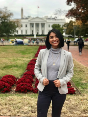 Kyra Solis smiling and posing in front of The White House in Washington, D.C.