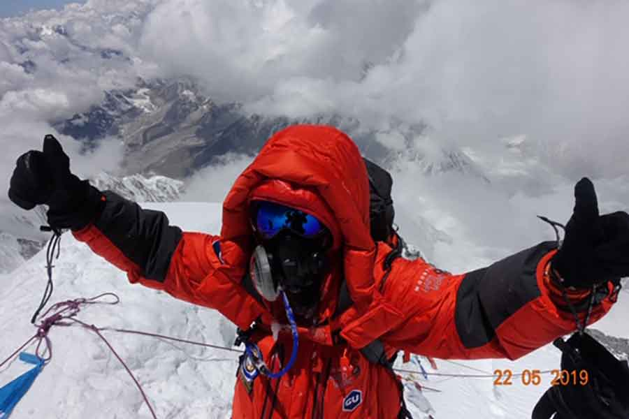 Roxanne Vogel at the top of Mt. Everest. Photo Credit to Lydia Bradey.