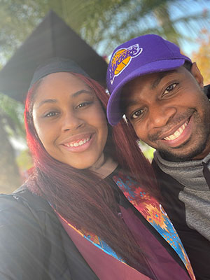 Kwashae Ruffin in her graduate cap and gown with her husband.