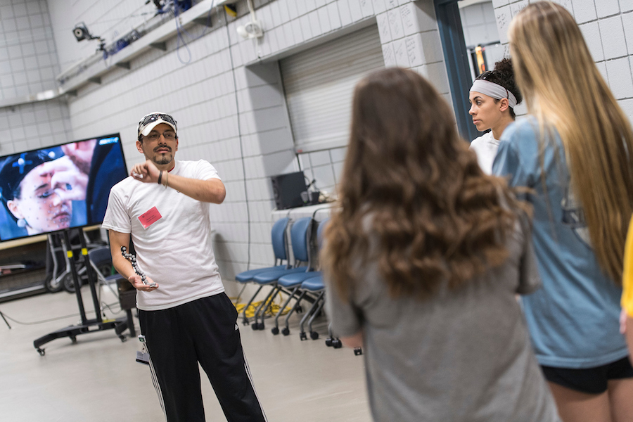 TWU PhD student talks with three high schoolers about motion capture technology