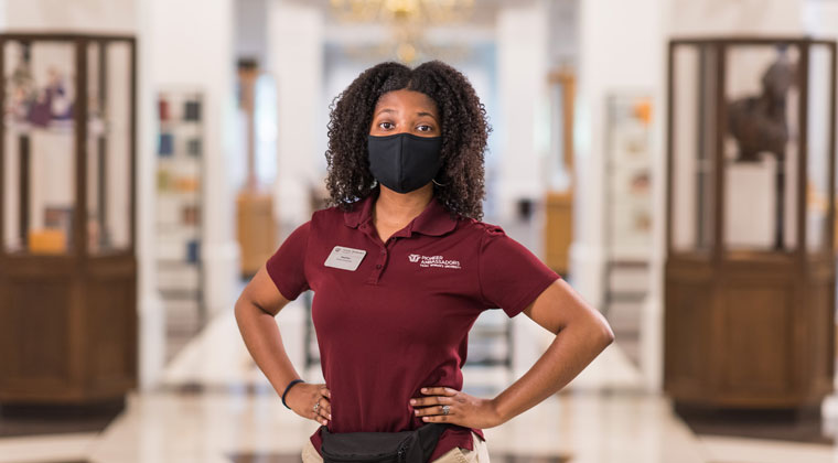 TWU student Heather Bennett wearing a mask in the TWU library