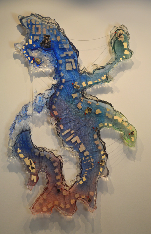 Resin with intaglio printed balsa wood, pins and string