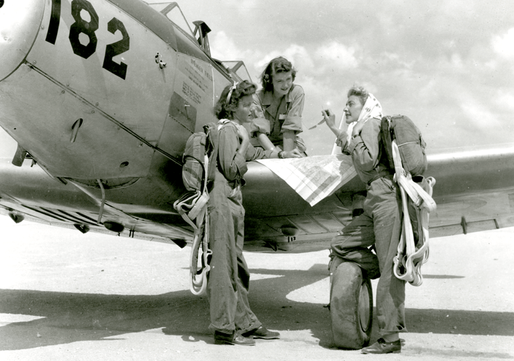 WASPs check their map prior to flight, Avenger Field, Sweetwater, Texas, August 1943.