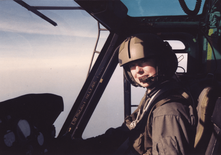 1LT Cheryl Pauley (WG #670) in a helicopter