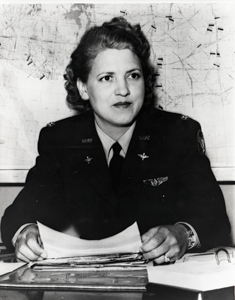 Jacqueline (Jackie) Cochran sitting at a desk wearing her WASP uniform