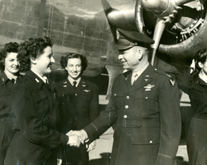 Douglas AAF, Douglas, Arizona. Jean Hixson (44-W-6) being congratulated by Gen. Hap Arnold. Geraldine Olinger (44-W-7) standing behind Jean Hixson on left.