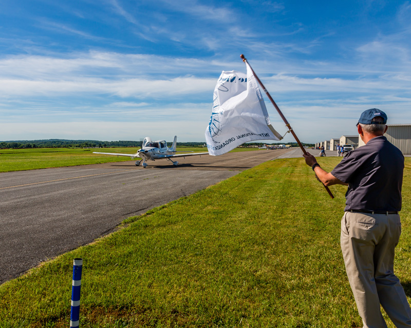 Air plane on runway with flag waving