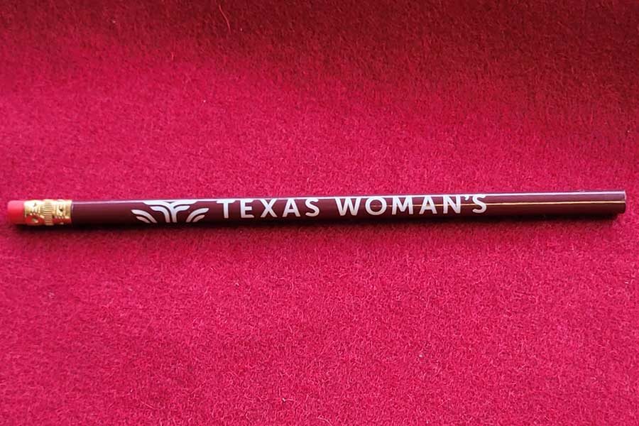 Maroon pencil with TWU logo on it