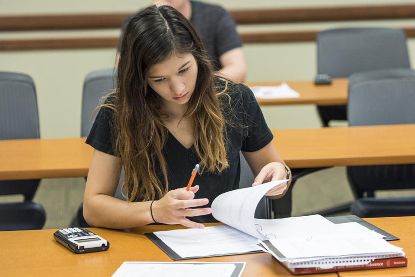 An undergraduate TWU mathematics student works on a probability and statistics assignment.