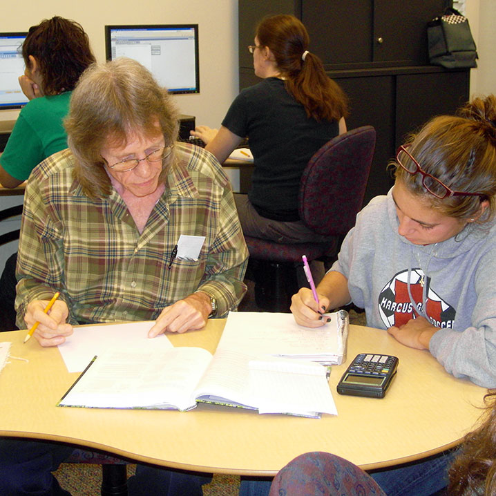 A tutor helping a student