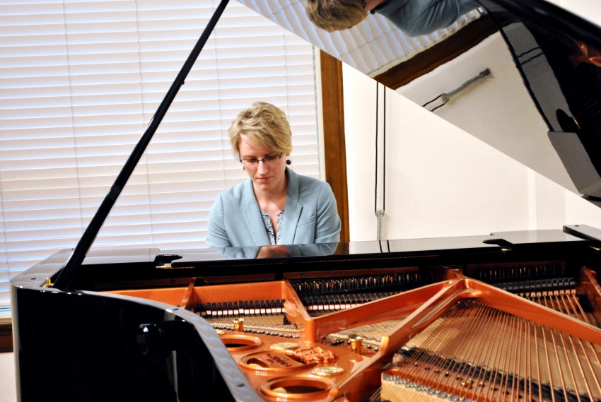 A TWU music student plays a piano