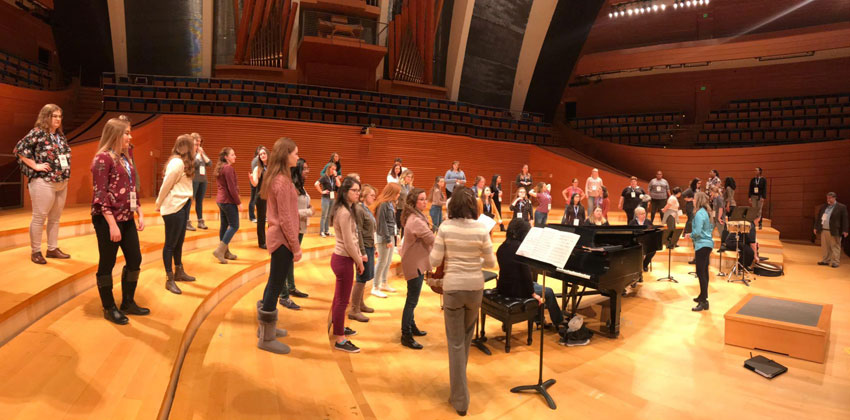 The TWU Concert Choir rehearses on the Margo Jones stage.