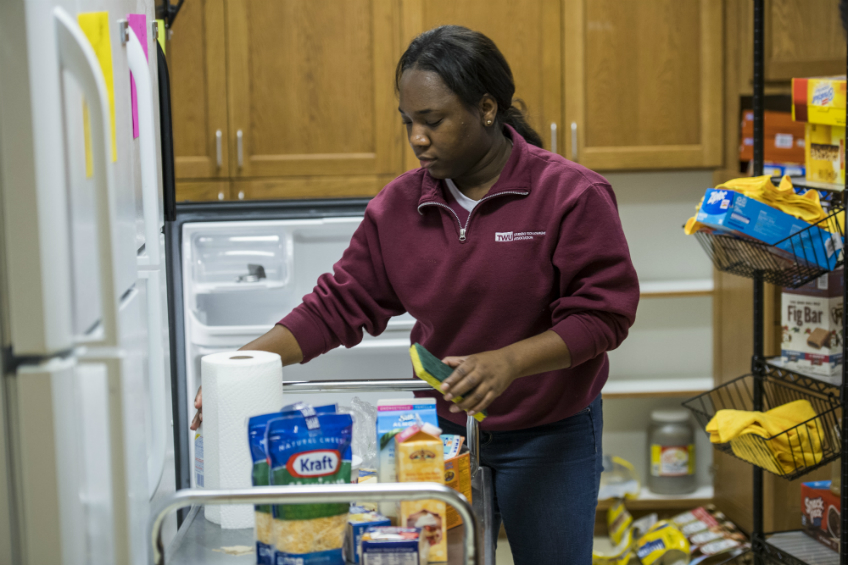 Brittany Sears, a psychology major from Dallas, Texas, cleans out the Food Pantry at Cumberland House