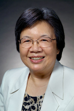 smiling asian woman wearing glasses