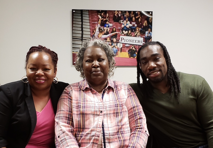 Matthews, his mother, Pauline Matthews, and his sister, Monique Coleman, smile in an office setting.