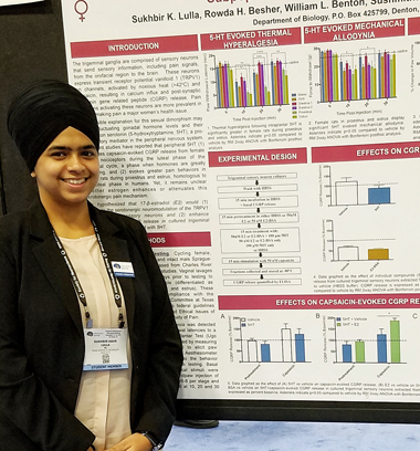 TWU doctoral student Sukhbir Kaur Lulla stands next to a presentation poster of her research