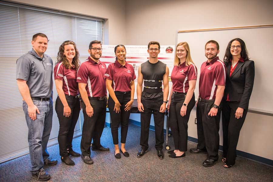 TWU Acolytes of Apollo Spring Team and professors show off garment designed for astronauts