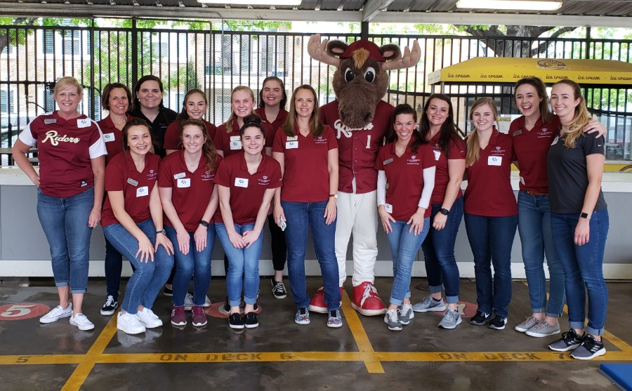 Group of TWU OT students help at RoughRiders Autism Awareness Night