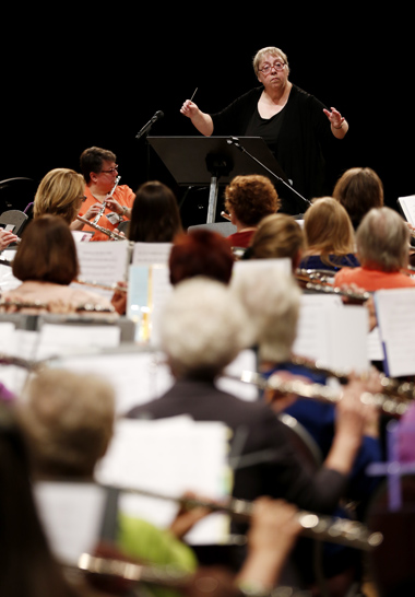 Pam Youngblood, DMA, professor and chair of the TWU Department of Music, conducts the 10,000 Lakes Flute Orchestra.