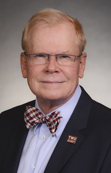 Man wearing glasses and a bow tie