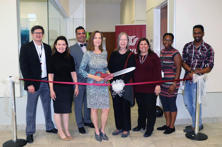 From left to right: Houston Food Bank representative Harry Hadland, Beth Lewis, Christopher Ray, Carolyn Moore, Deborah Unruh, Monica Mendez-Grant, Houston Food Bank representative Jasmin Sherman, and student Torrey Alexis for the Student Food Market ribbon cutting ceremony