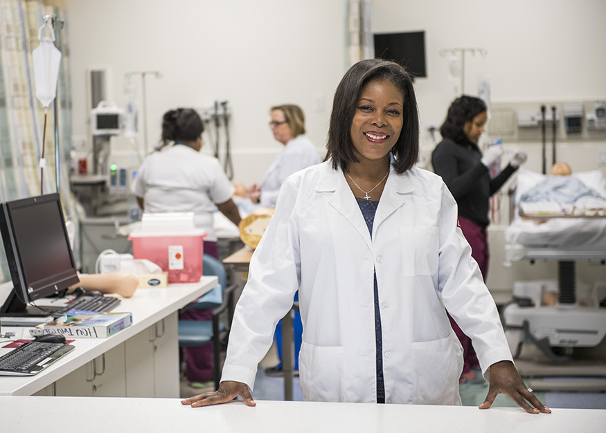 nurse educator smiling in lab coat