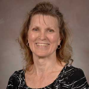 A headshot of Karen Moreland.