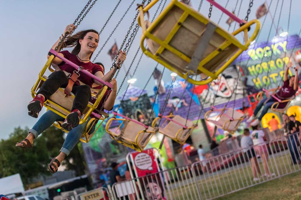 A TWU student on a carnival ride at the North Texas State Fair.