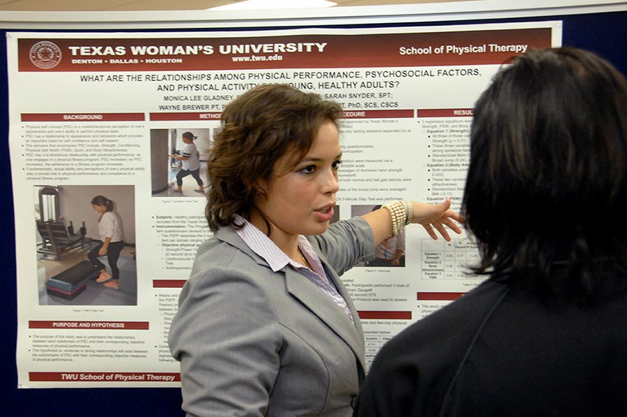 PT student shares her research poster with others