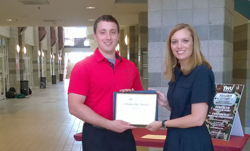 Scholarship recipient Nick Levine with Heritage Health Solutions CEO Tonya Clark