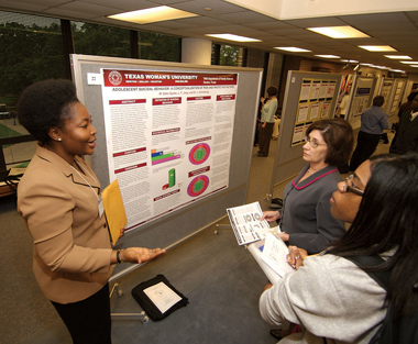Student presenting research at a symposium