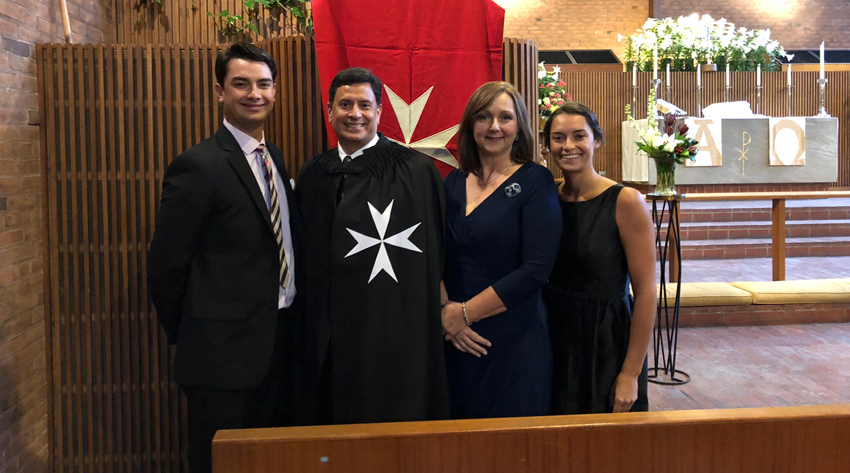 Ronald S. Palomares-Fernandez, Ph.D. (second from left), was joined by his family at his investiture ceremony on April 7 in Boston.