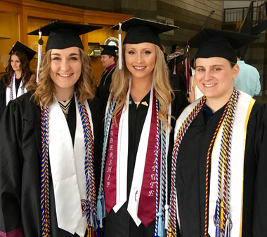 3 Psi Chi graduates with stoles and honor cords