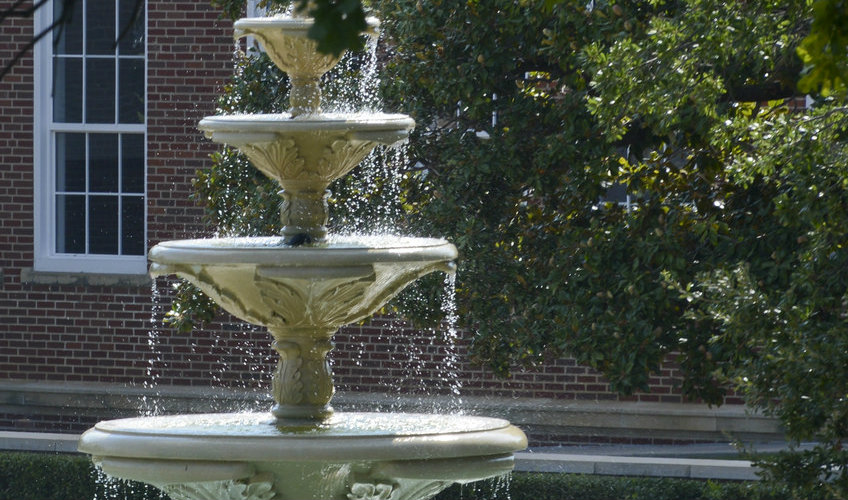 Top part of a water fountain in front of the Redbud Theater Complex.