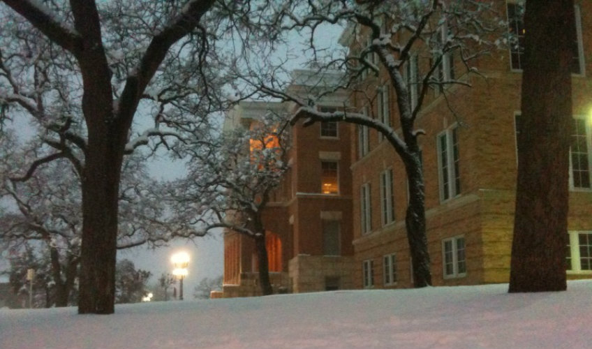 Snow fall with TWU's Old Main Building in the back.