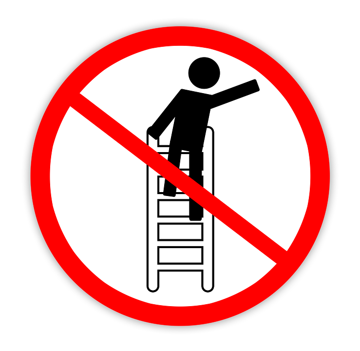 "The ""no"" symbol with a figure on a ladder reaching over to the side."