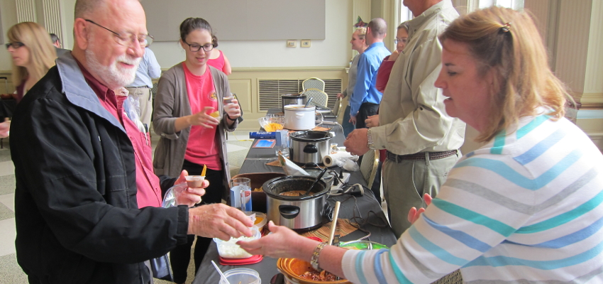 Faculty & Staff Serving Chili at SECC event
