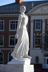 A photo of a statue of a woman on Texas Woman's University's Denton campus.