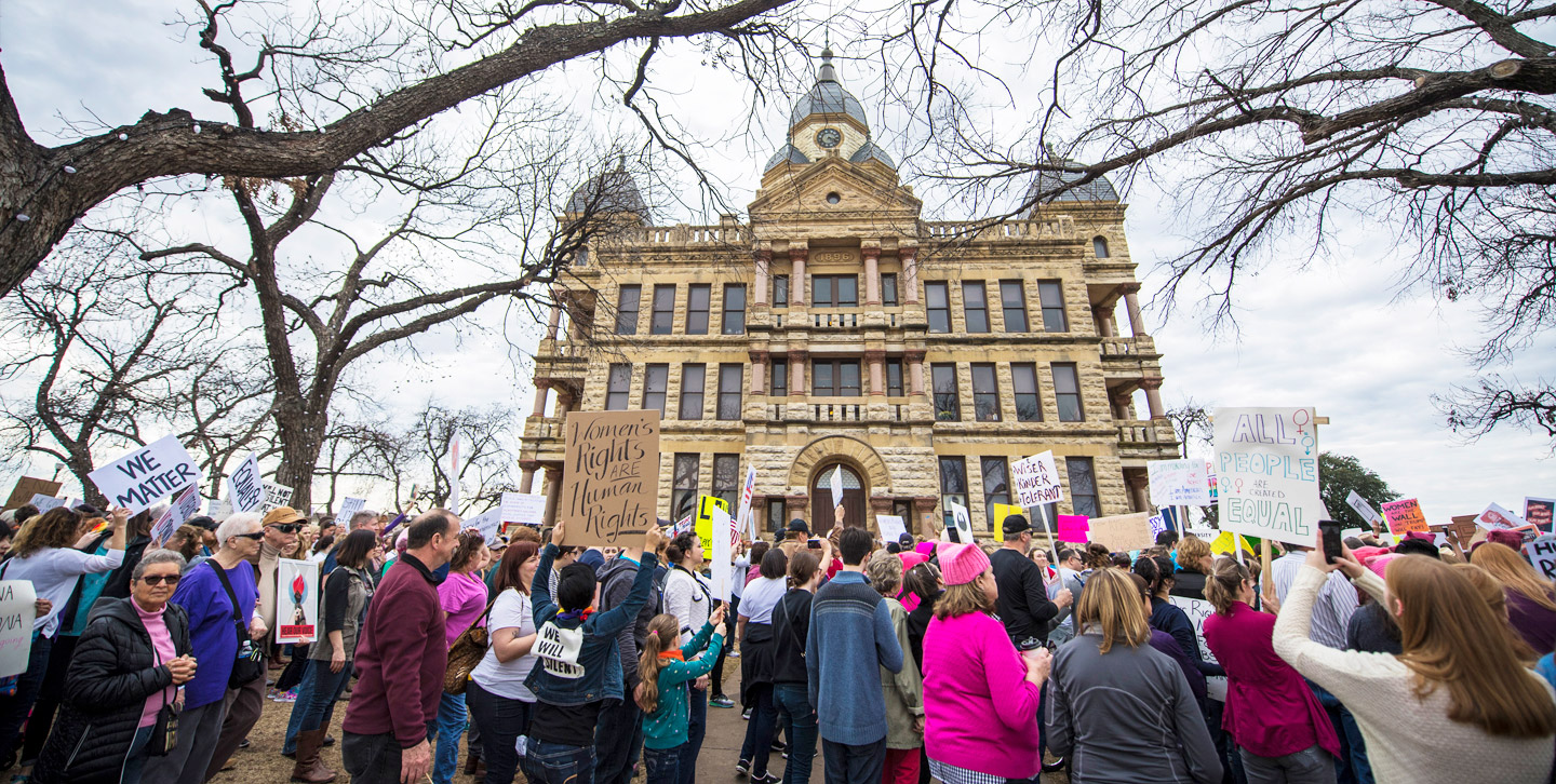 Citizens marching with signs at the Denton Women's March