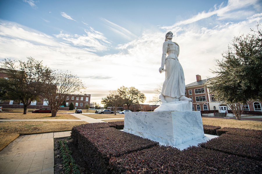 TWU's Minerva statue, pictured in front of the Ann Stuart Science Complex at sunrise.