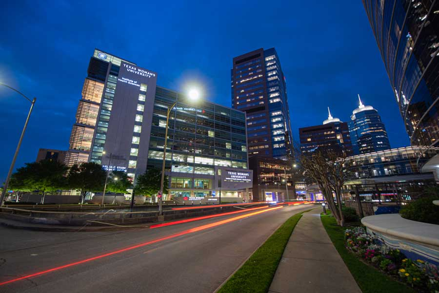 TWU's Houston campus lit up at night.