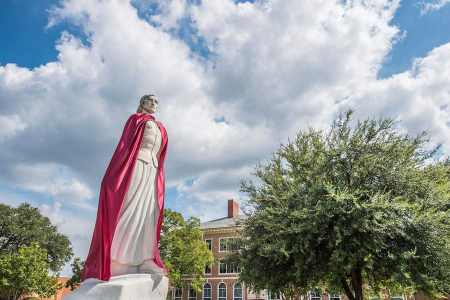 TWU Minerva statue wears a maroon Wonder Woman-esque cape